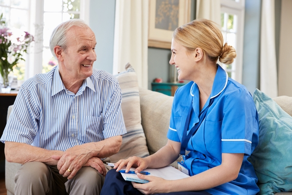 Bella Home Care - Carer With a Patient