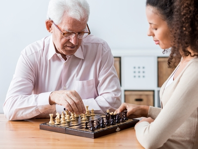 Bella Home Care - Carer Playing Chess With Patient