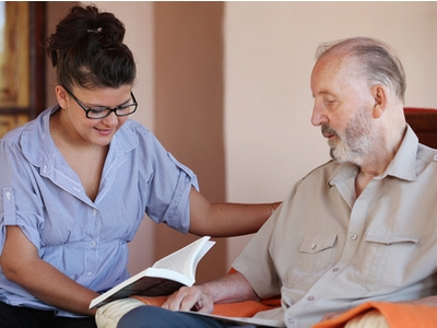 Bella Home Care - Carer Reading To a Patient