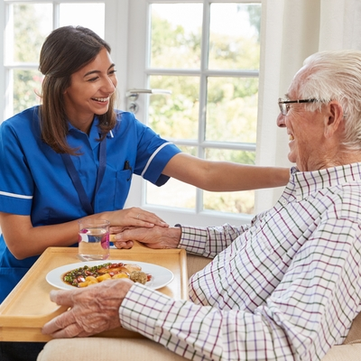 Bella Home Care - Leamington Spa - Carer Helping Elderly Patient With His Meal